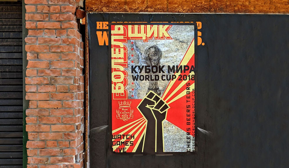 Russian Takeover poster on brick wall